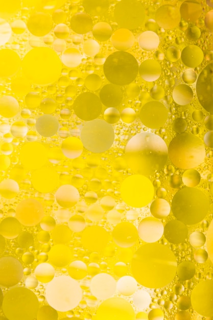 Bubble effect on yellow textured background Free Photo