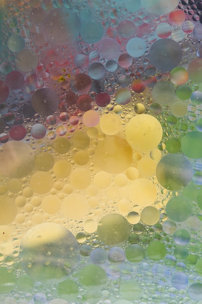 Bubble textured over the colorful background Free Photo