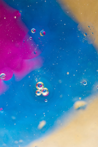 Bubbles over the pink; blue and beige background Free Photo