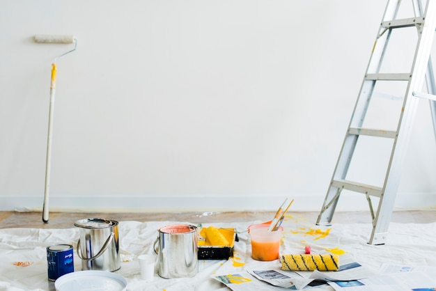Buckets of paint on the floor Free Photo