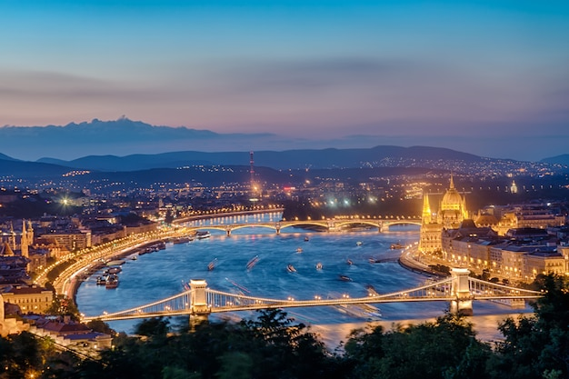 Budapest panorama with parliament and bridges during blue hour sunset. Premium Photo