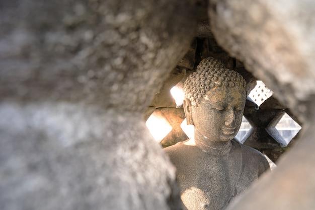 Buddha statue in borobudur, buddist temple in yogyakarta, indonesia Premium Photo