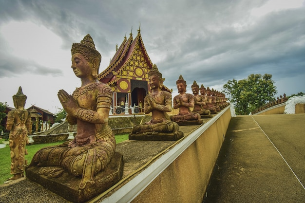Buddhism temple in thailand in a rainy day Premium Photo