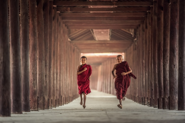Buddhist novice are walking in temple, myanmar Premium Photo