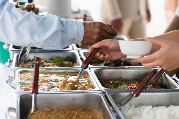 Buffet dinner restaurant catering food concept. Premium Photo