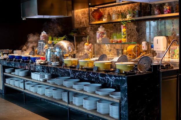 Buffet line for breakfast in luxury hotel. Premium Photo