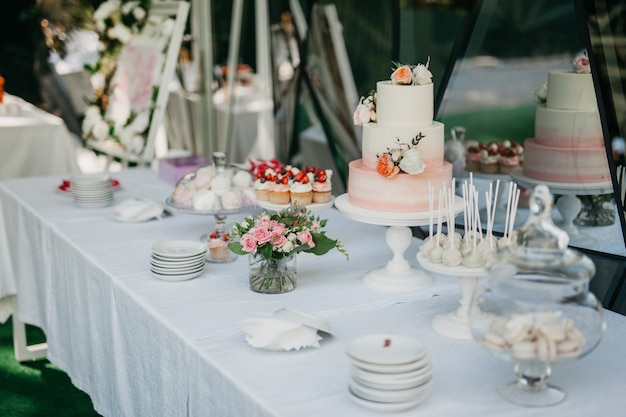 Buffet table with cake and muffins Premium Photo