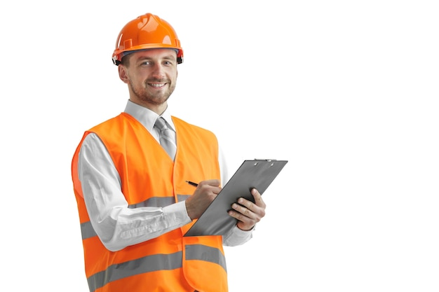 The builder in a construction vest and orange helmet standing on white studio background. safety specialist, engineer, industry, architecture, manager, occupation, businessman, job concept Free Photo