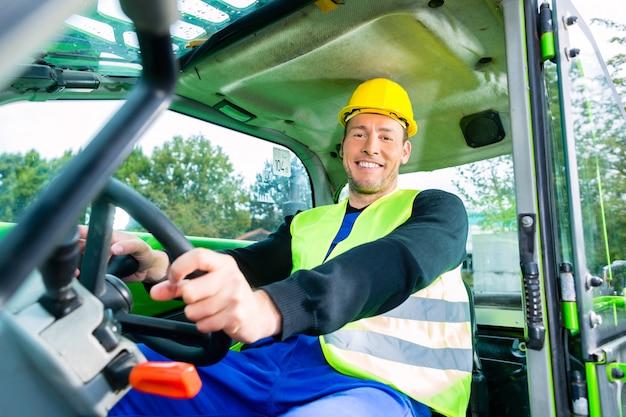 Builder driving construction machinery Premium Photo