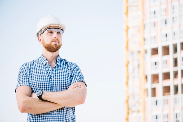 Builder posing on site Free Photo