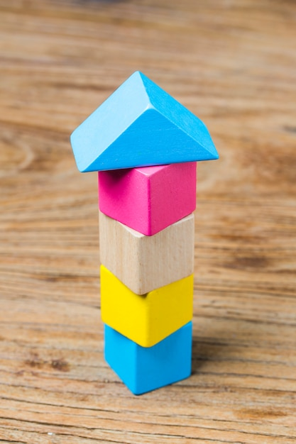 Building blocks on wooden background,colorful wooden building blocks Free Photo