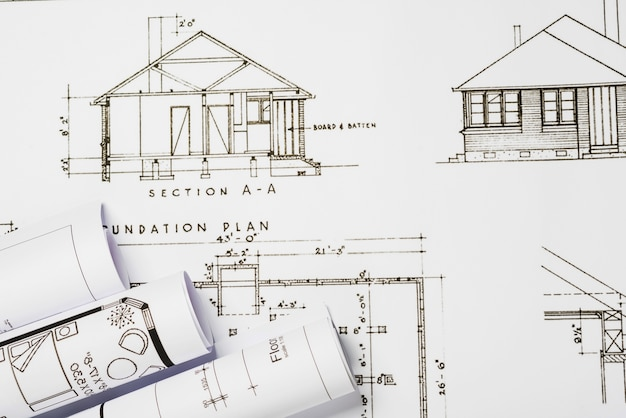 Building blueprints on table free photo