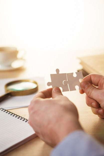 Building a business success. hands with puzzles Free Photo