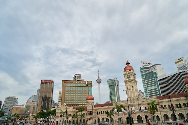 Building of a city with cloudy sky Free Photo