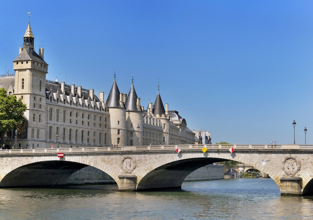 Building of the conciergerie in paris view from riverbank of the seine from bridge of invalides Premium Photo