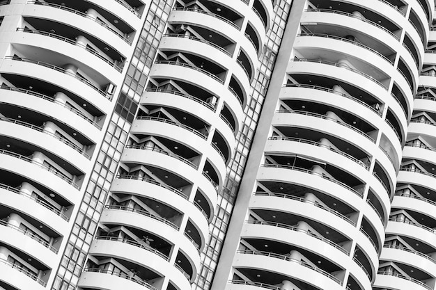 Building exterior with window balcony pattern Free Photo
