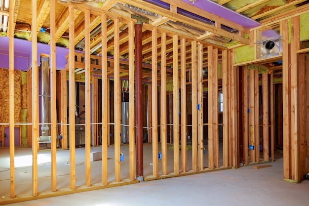 Building the frame of a wooden house. inside the frame. boards for flooring, vapor barrier walls. Premium Photo