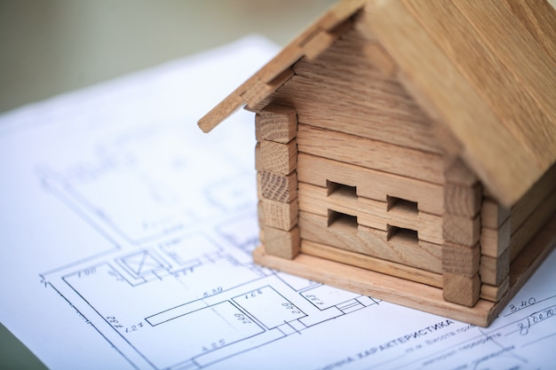 Building house on blueprints with plan - construction project Premium Photo