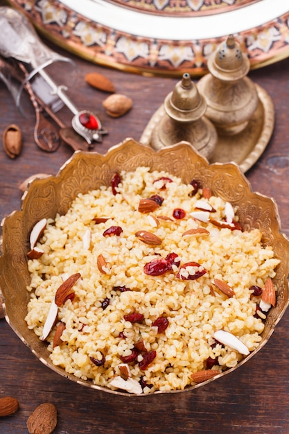Bulgur with dried cherries and almonds Premium Photo