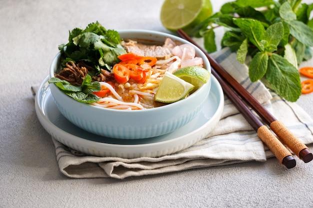 Bun bo hue, bun bo, vietnamese beef noodle soup spicy. Premium Photo