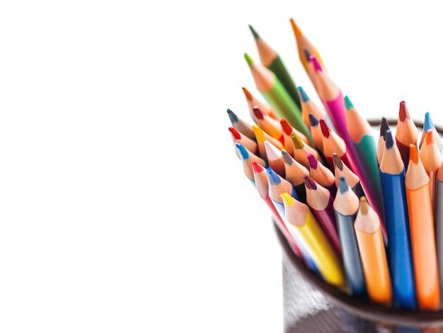Bunch of colorful watercolor pencils. school supplies. Premium Photo