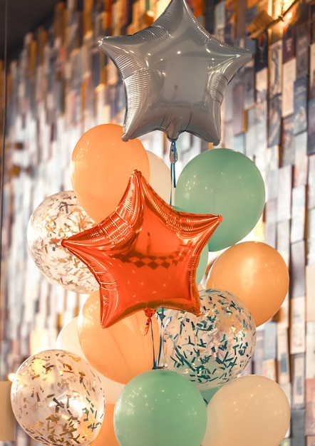 A bunch of different colored balloons holiday concept Free Photo