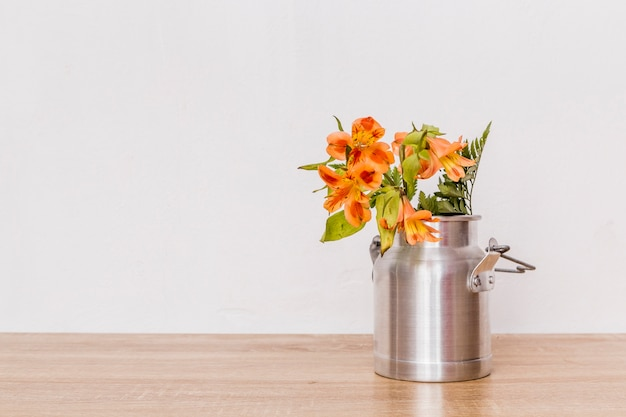Bunch of flowers in milk can Free Photo