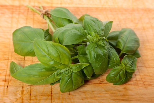 Bunch of fresh basil on wooden board Free Photo