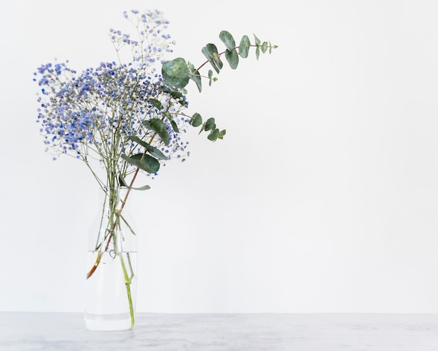 Bunch of fresh flowers on stems in vase Free Photo