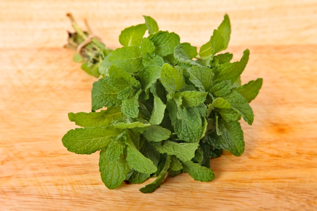 Bunch of fresh mint on wooden board Free Photo