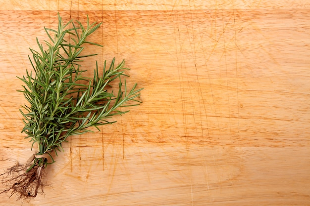 Bunch of fresh rosemary on wooden board Free Photo
