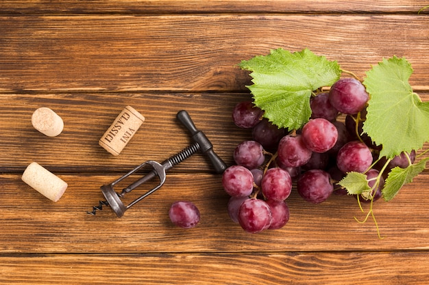 Bunch of grapes on wooden table Free Photo