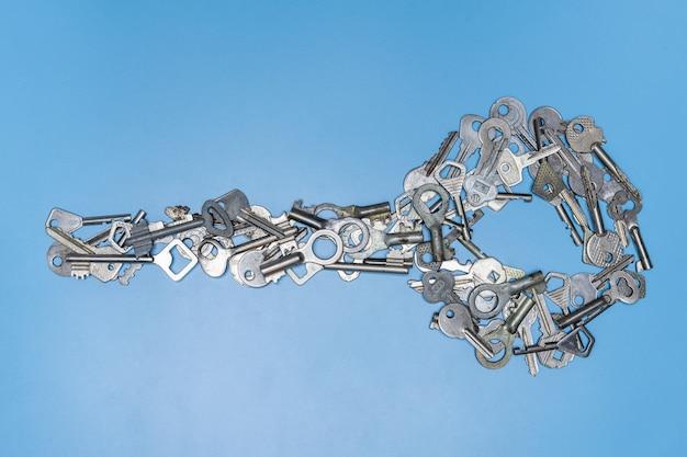 Bunch of keys in shape of big key concept Premium Photo