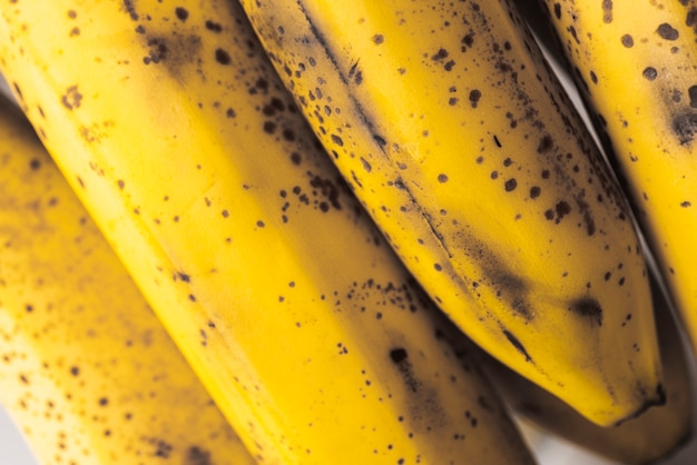 Bunch of ripe bananas with dark spots Free Photo