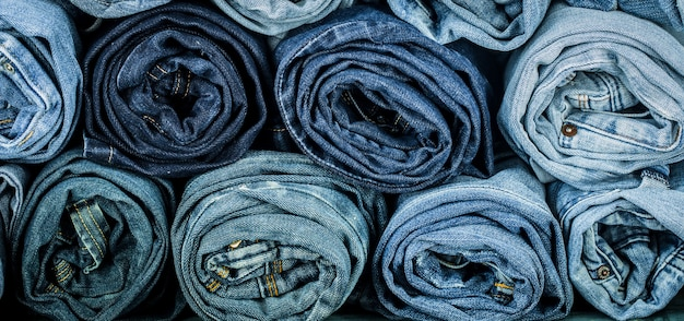 A bunch of twisted jeans, close-up, fashionable clothes Free Photo