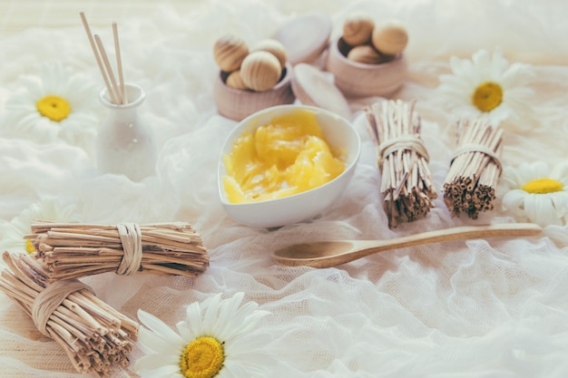 Bunches of sticks and shea butter Free Photo