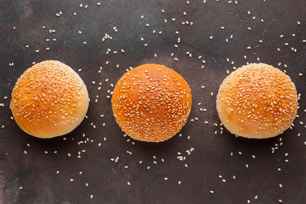 Buns with sesame seeds and textured background Free Photo
