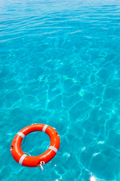 Buoy orange floating in perfect tropical beach Premium Photo