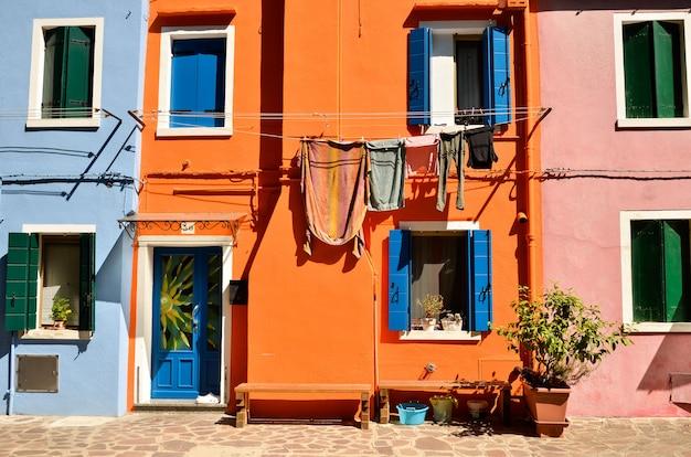 Burano island near venice, italy. colorful concept, orange and blue Premium Photo