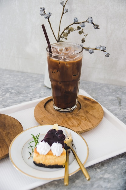 Burberry cheese cake and iced cocoa glass focus on class Premium Photo