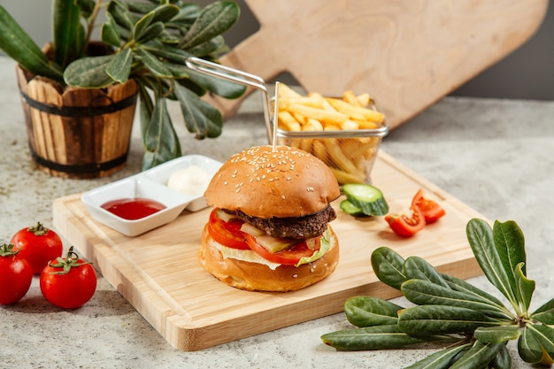 Burger served with french fries and ketchup Free Photo