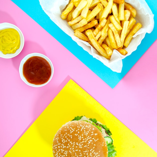 Burger with french fries with ketchup and mustard Free Photo