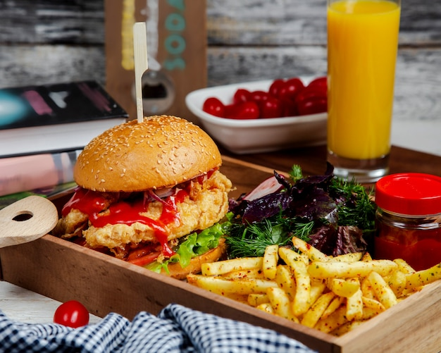 Burger with herbs and spicy french fries Free Photo