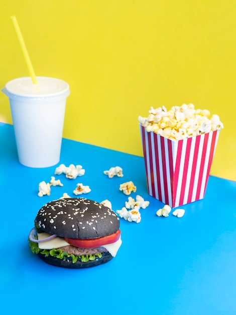 Burger with soda and popcorn Free Photo