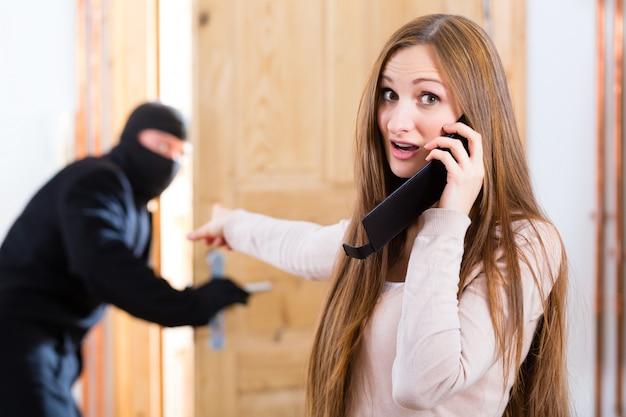 Burglary crime - culprit and victim Premium Photo