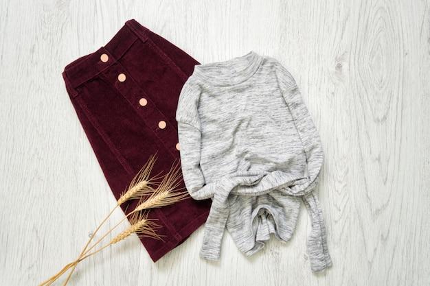 Burgundy suede skirt and gray sweater, Premium Photo