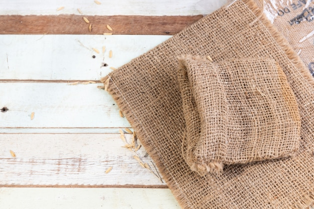 Burlap or sackcloth on wood table top view Premium Photo
