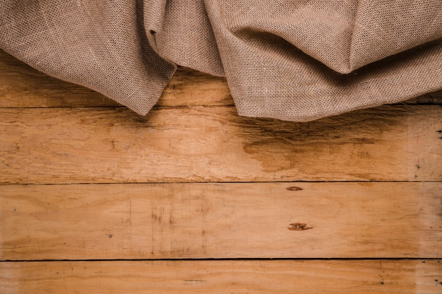 Burlap texture on wooden table background Free Photo