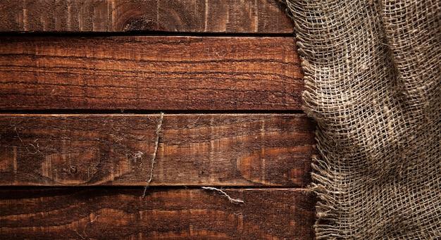 Burlap texture on wooden table Premium Photo