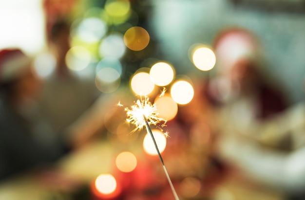 Burning bengal light on blurred background Free Photo